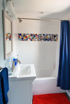 Framed By White Subway Tiles The Colorful Accent In Aptly Named Bubbles Pattern Is Shown Antique Pewter Baby Blue Deco Cobalt Fire